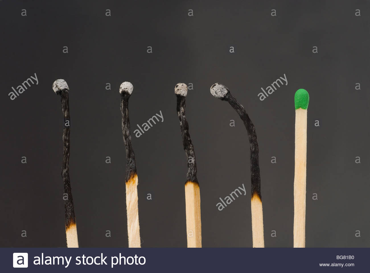 Close up shot of matches on black - Stock Image