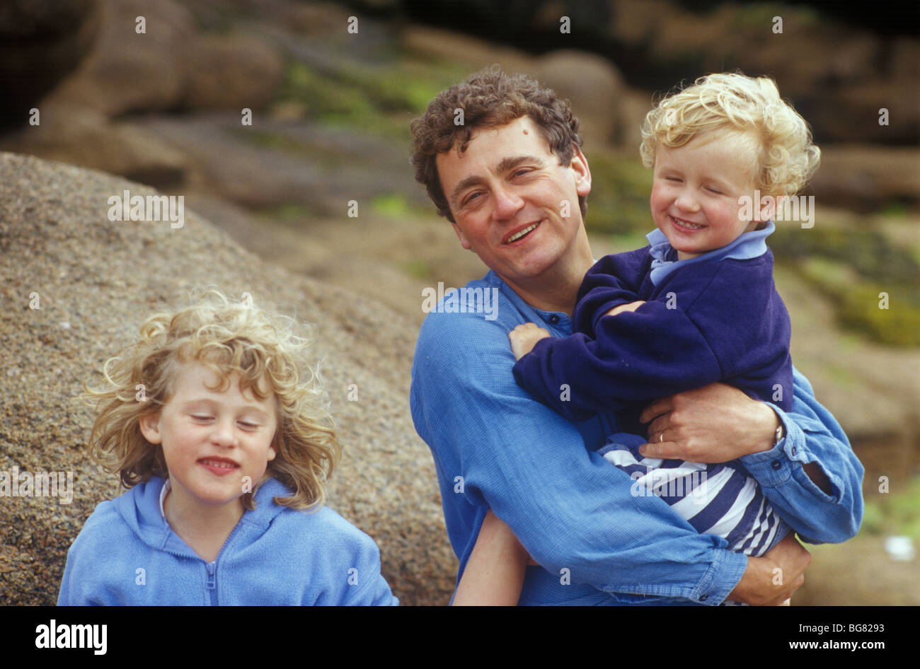 father with son and daugher showing family resemblance - Stock Image