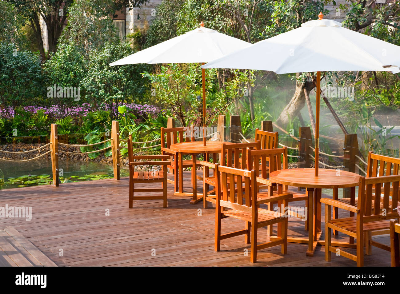 House patio with table and chairs under umbrella Stock Photo