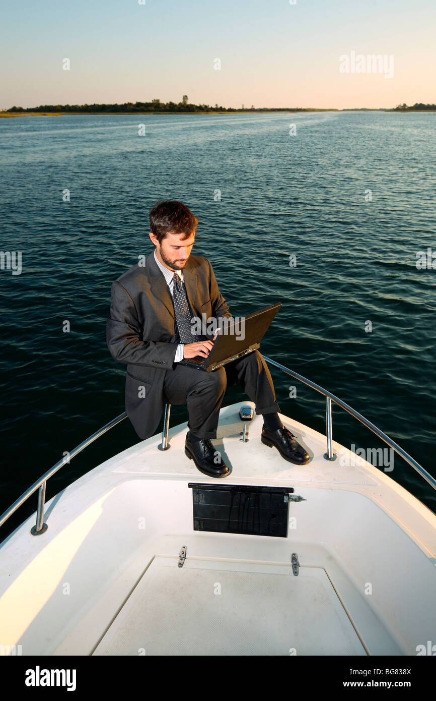 Businessman Working Computer On Boat Stock Photos