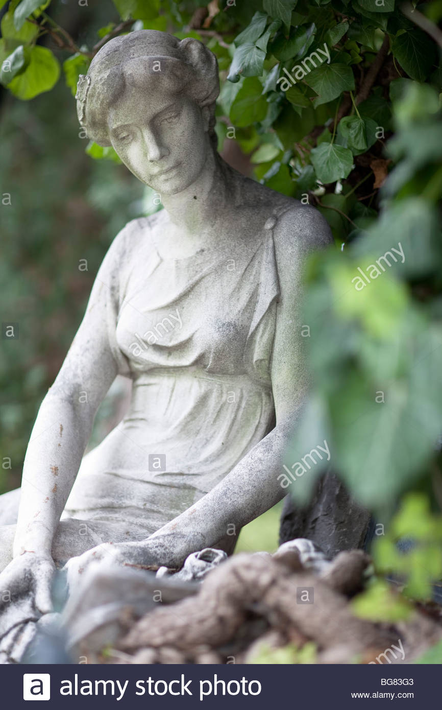 marble statue on cemetery - Stock Image