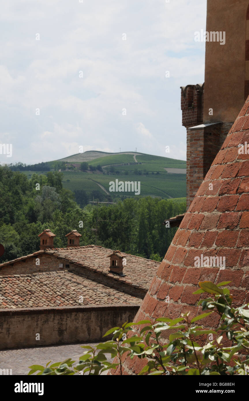 Clay tiled roofs and views of the vineyards around Barolo castle Langhe Piedmont Italy - Stock Image