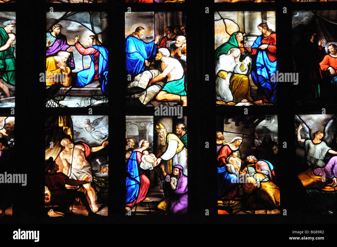 Detail of beautiful stained glass windows in il Duomo di Milano Milan cathedral Lombardy Italy Stock Photo