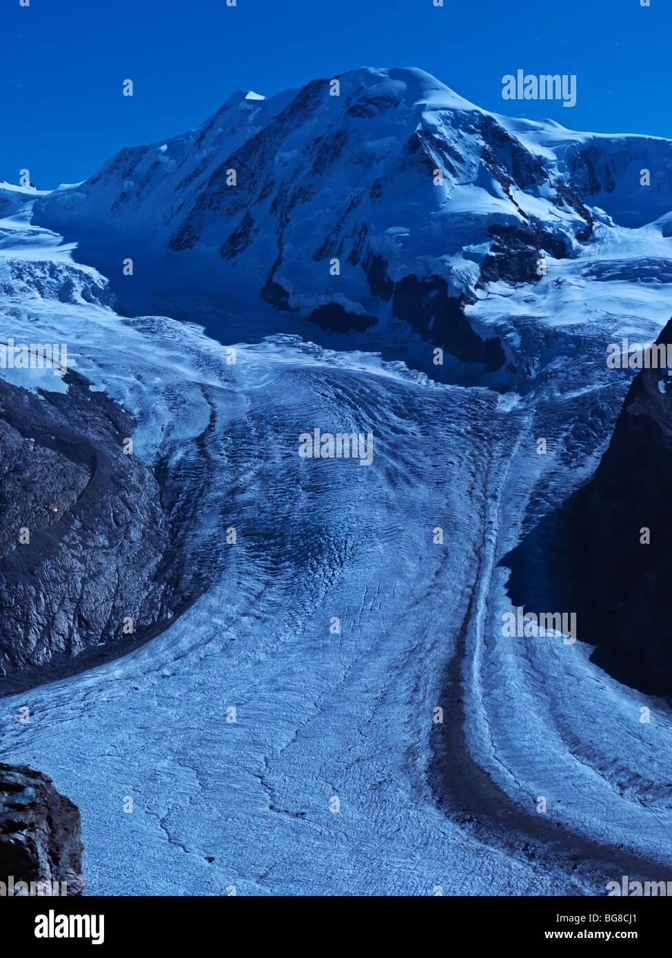 Switzerland, Valais, Zermatt, Gornergrat,Mount Breithorn and the Gorner Glacier illuminated by moon light - Stock Image