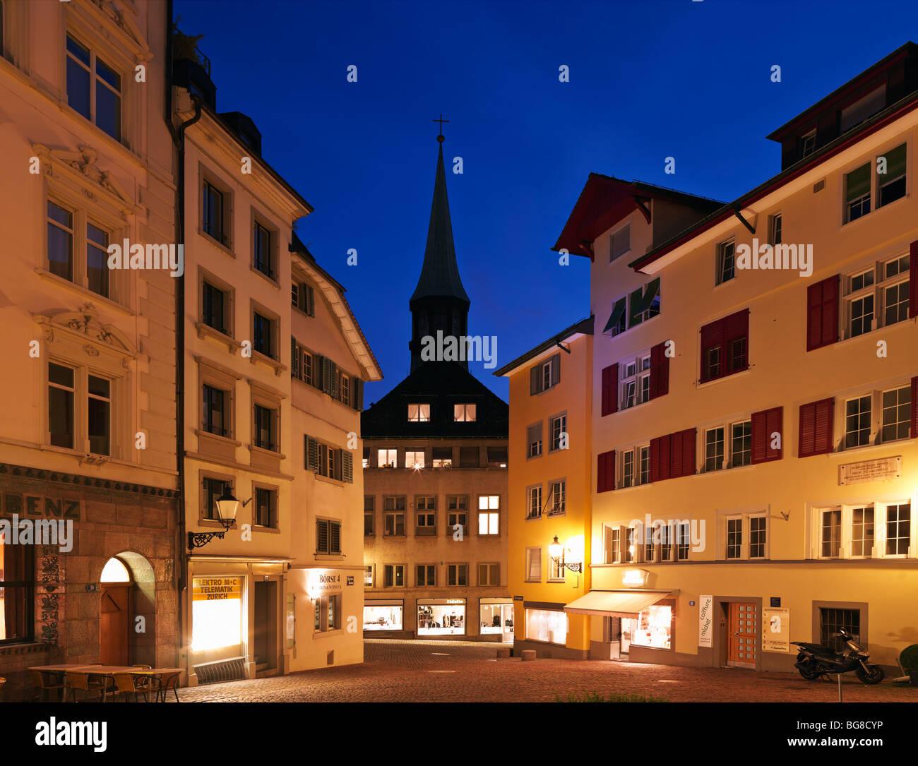 Switzerland, Zurich,Old Town Zurich, street scene with view of Augustiner Church at dusk - Stock Image