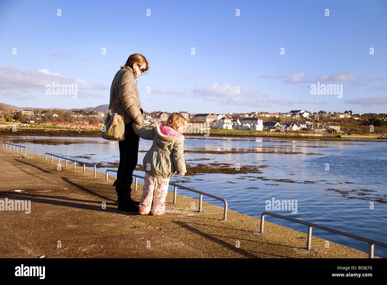 Single mother and child out for a walk - Stock Image