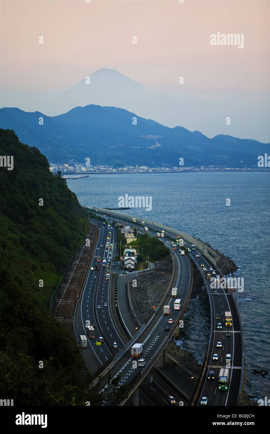 Aerial view of the Tomei Expressway. In the background, the silhouette of Mount Fuji. Japan. - Stock Image