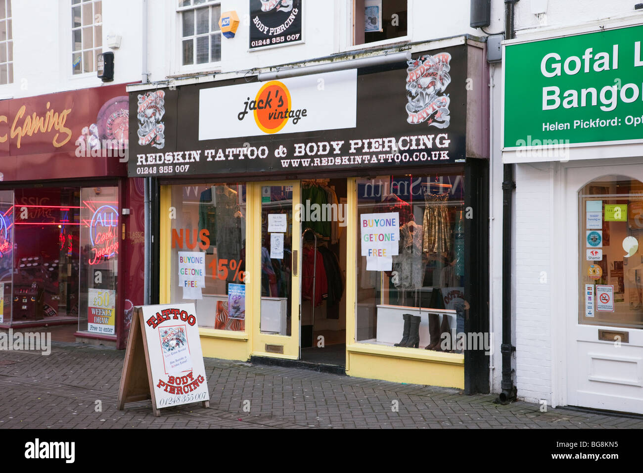 10a96355f High Street, Bangor, Gwynedd, North Wales, UK. Tattoo and body piercing shop  front on the High Street.