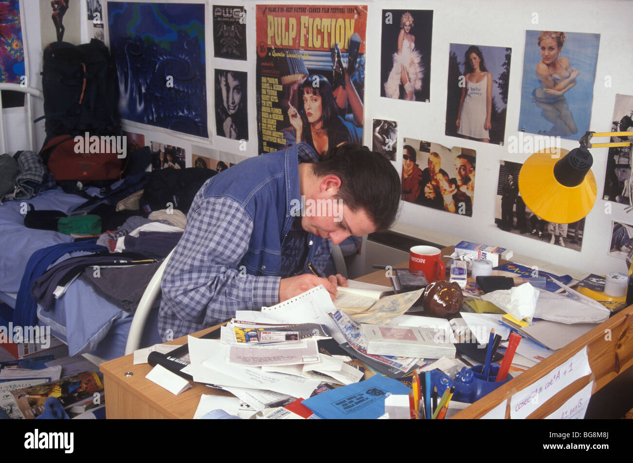 Astonishing Teenage Boy Doing His Homework At His Messy Desk In His Home Interior And Landscaping Ferensignezvosmurscom