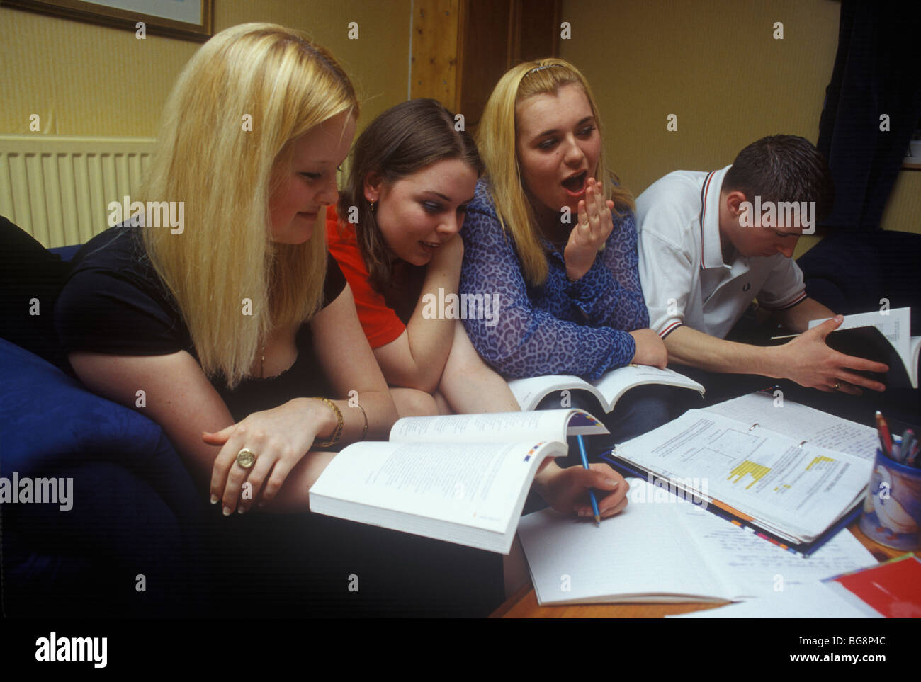 group of teenagers revising together for their a levels - Stock Image