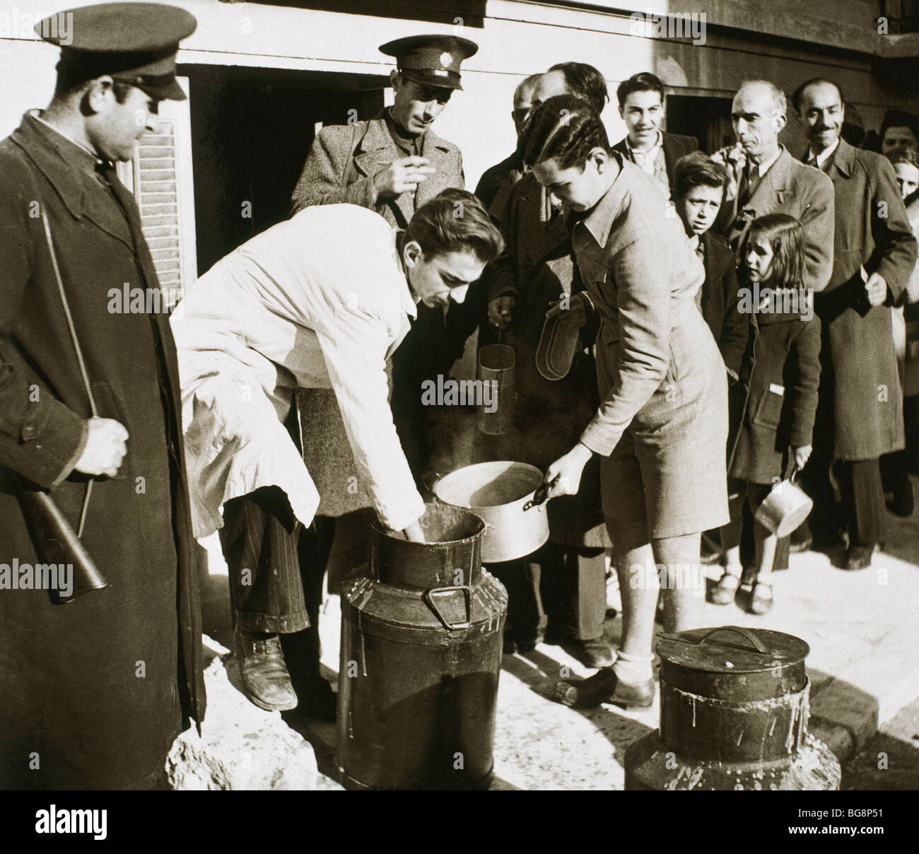 Second World War (1939-1945). The Allies spread food between Greek population with ration card. March 1940. Athens. - Stock Image