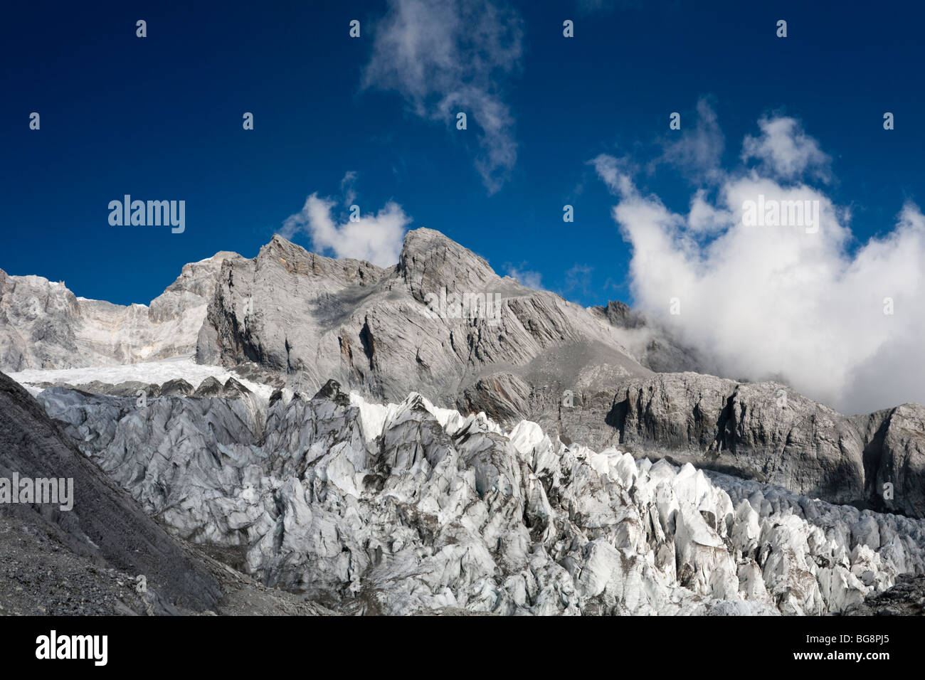View of glacier on Jade Dragon Snow Mountain (Yulong Xueshan Mountain or Mt Satseto) from Dry Sea Meadow (Ganhaizi) Stock Photo