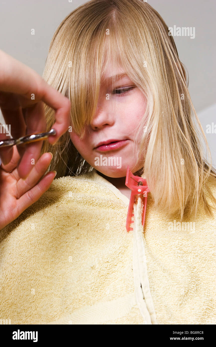 Child fearing hair scissors accident - Stock Image
