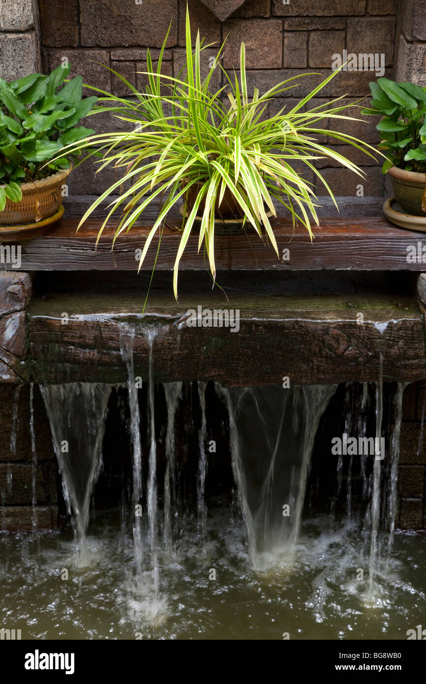 Garden water feature small waterfall - Stock Image
