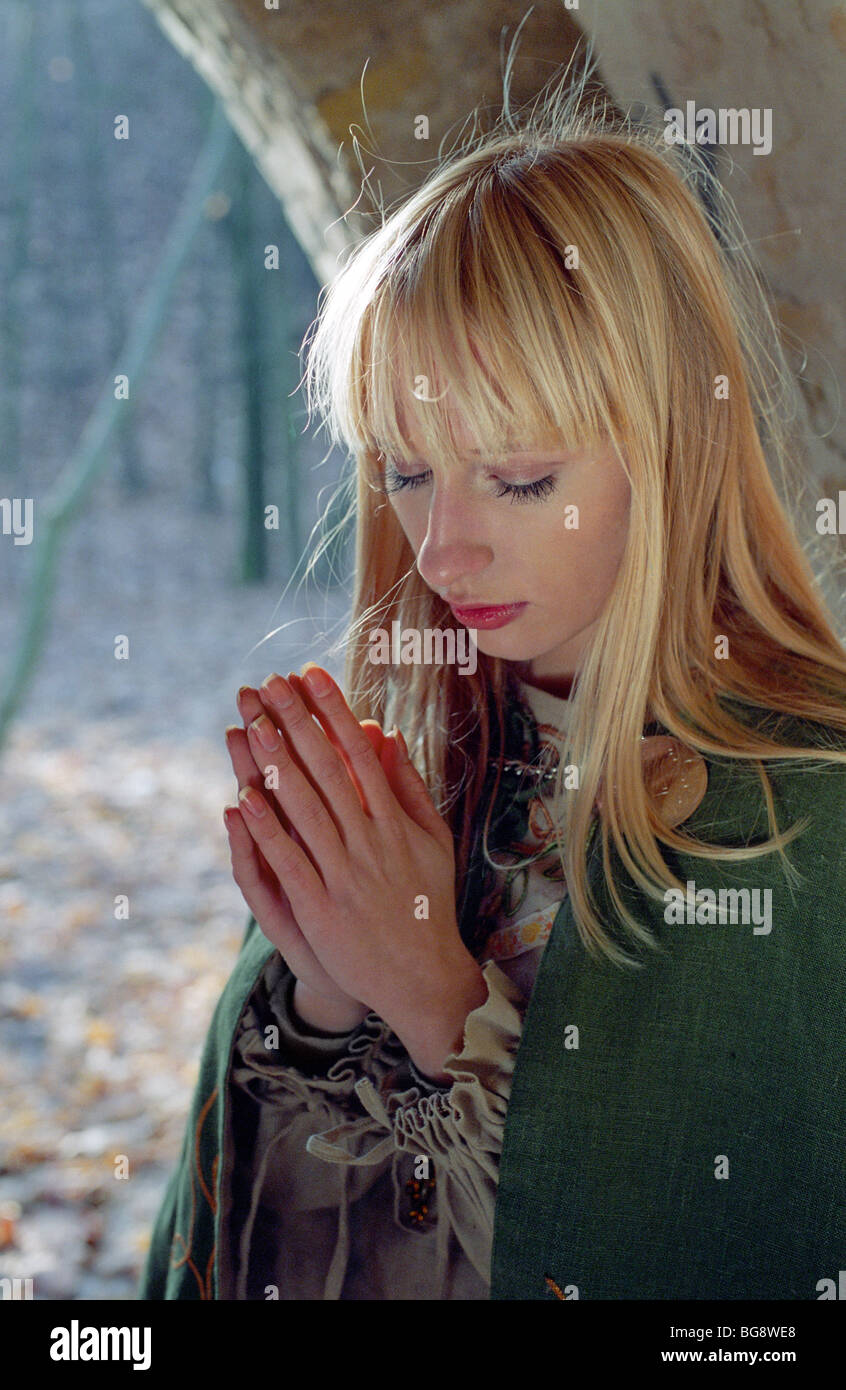 medieval woman praying in castle Stock Photo