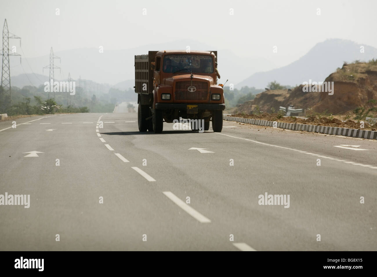 India Rajasthan truck driving against arrows, wrong way on road - Stock Image