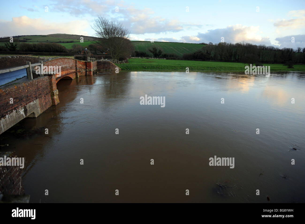 The river ouse at alfriston burst its banks and along with heavy rain flooded the surrounding fields Stock Photo
