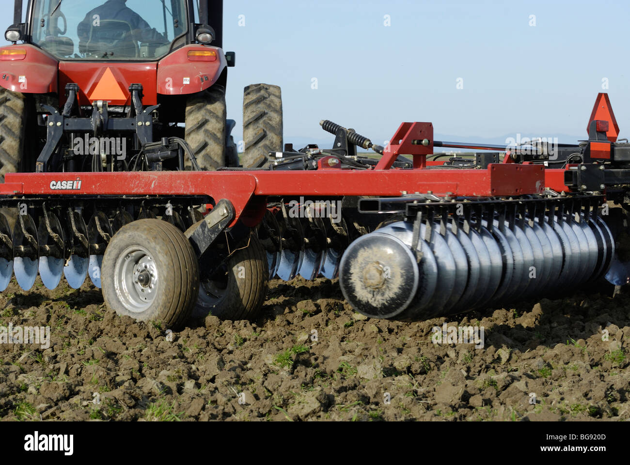 Close-up of Disk Rippers being pulled by a Case Tractor - Stock Image