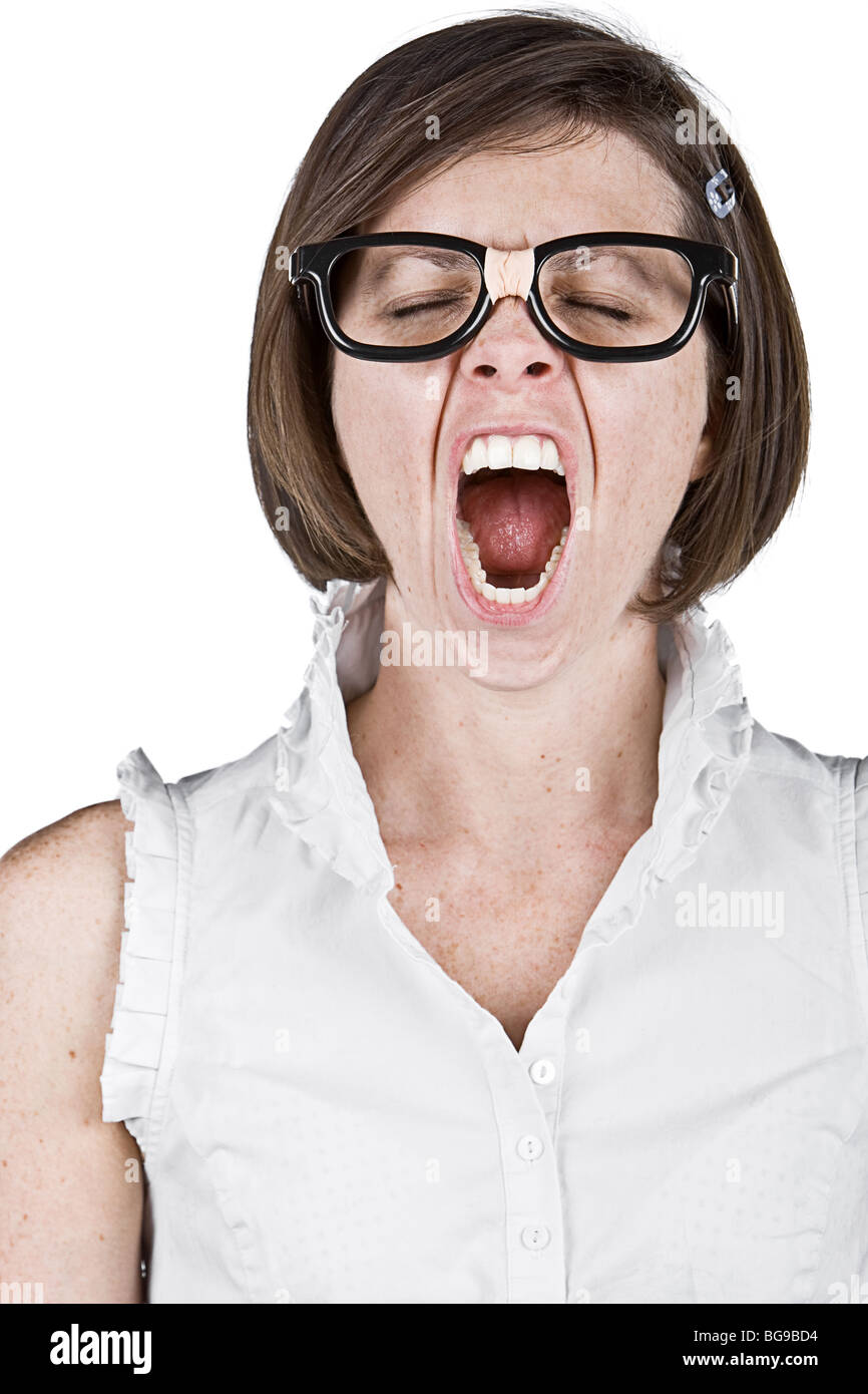 Humourous Shot of a Geeky Female Yawning - Stock Image