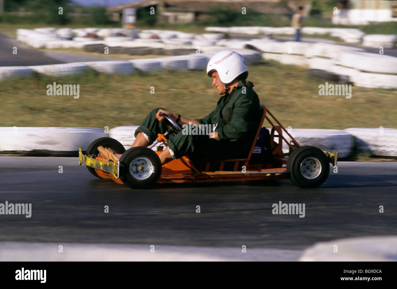 Man driving a go kart around a corner Stock Photo: 27252970