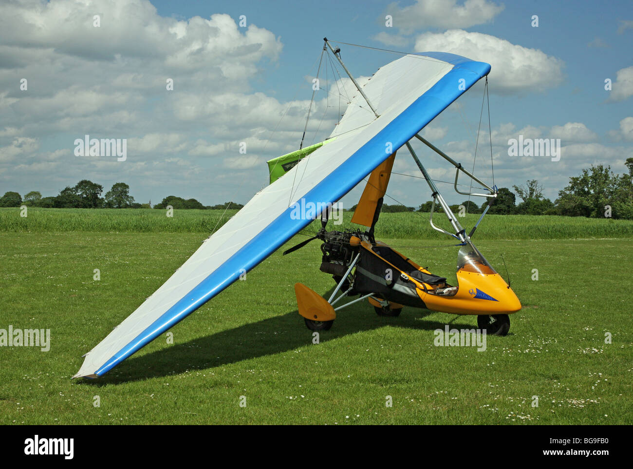 microlight aircraft waiting on the ground without any people - Stock Image
