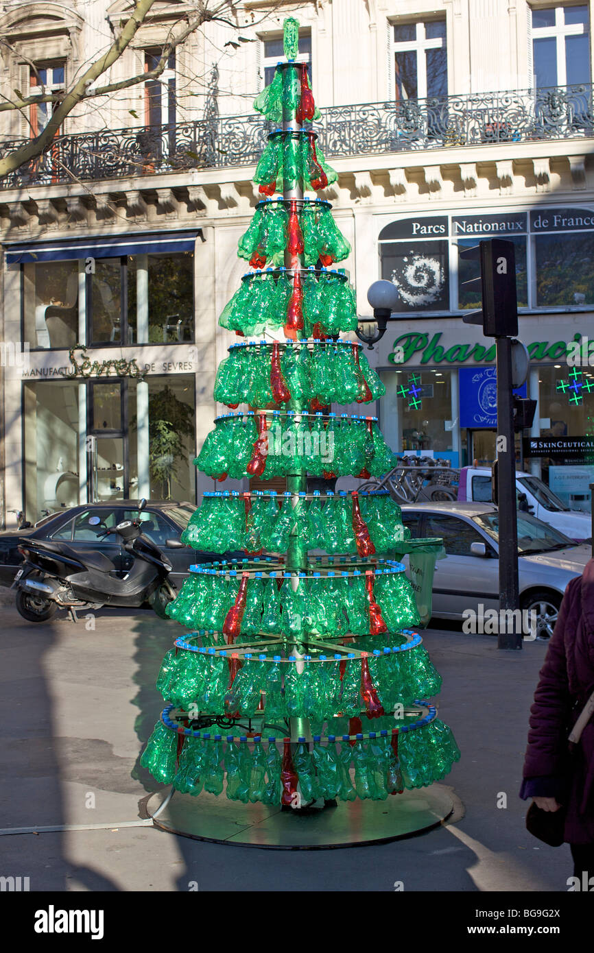 Christmas tree made from recycled green plastic bottles in Paris - Stock Image