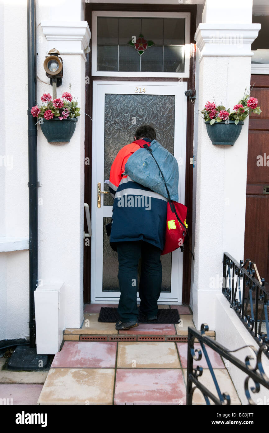Postman delivering letters, England, UK - Stock Image
