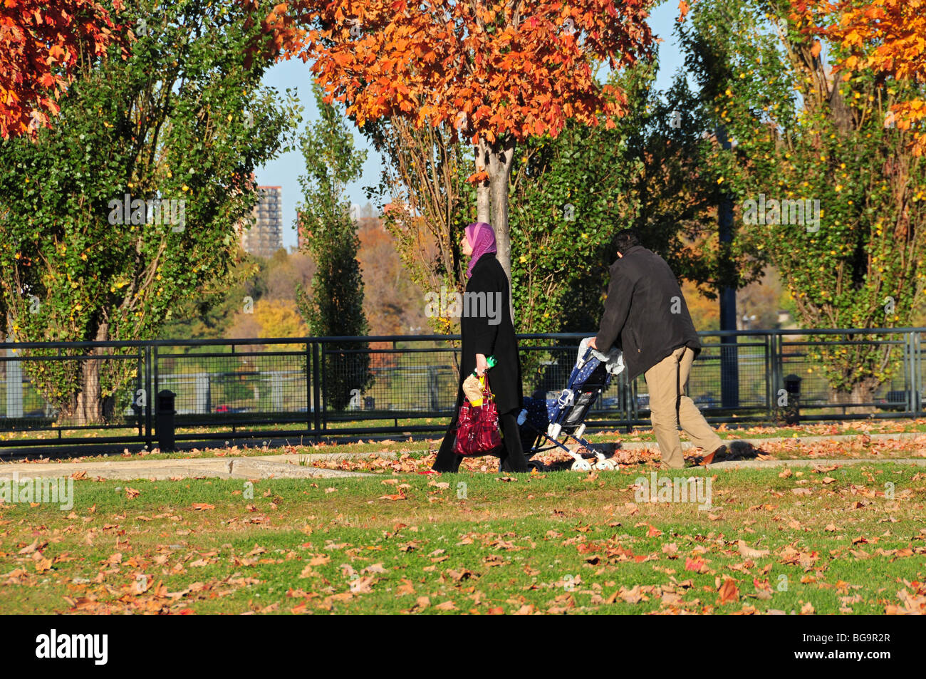 Family walking in a park Montreal - Stock Image
