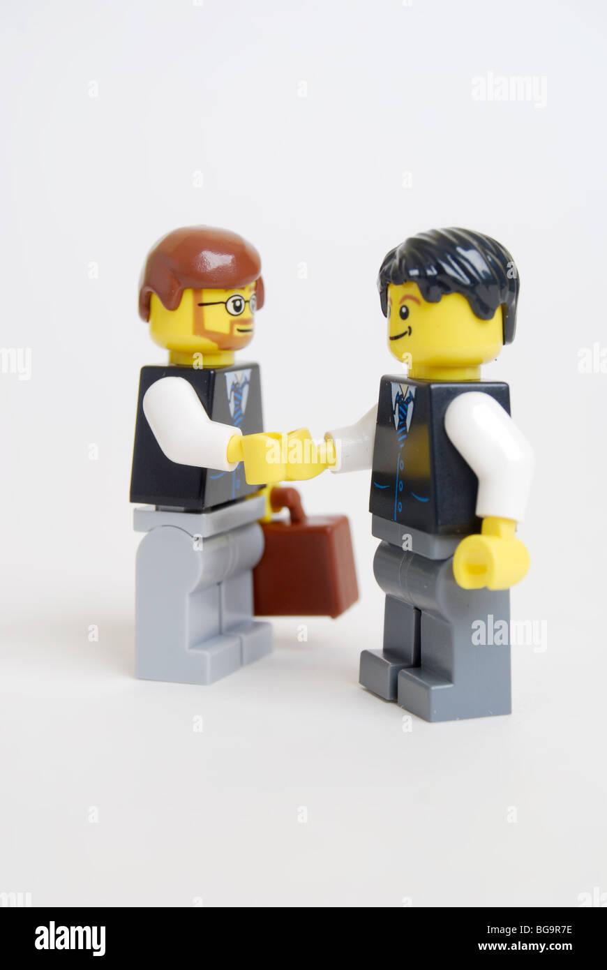 Business people Business men handshake deal agreement lego men smiling Stock Photo
