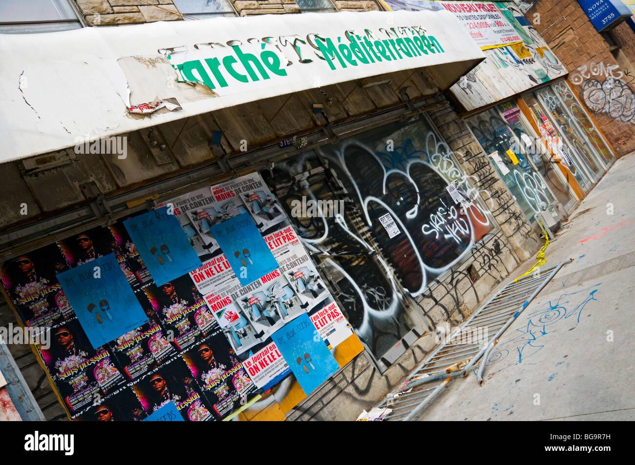 Closed rundown shops boulevard Saint Laurent Montreal - Stock Image