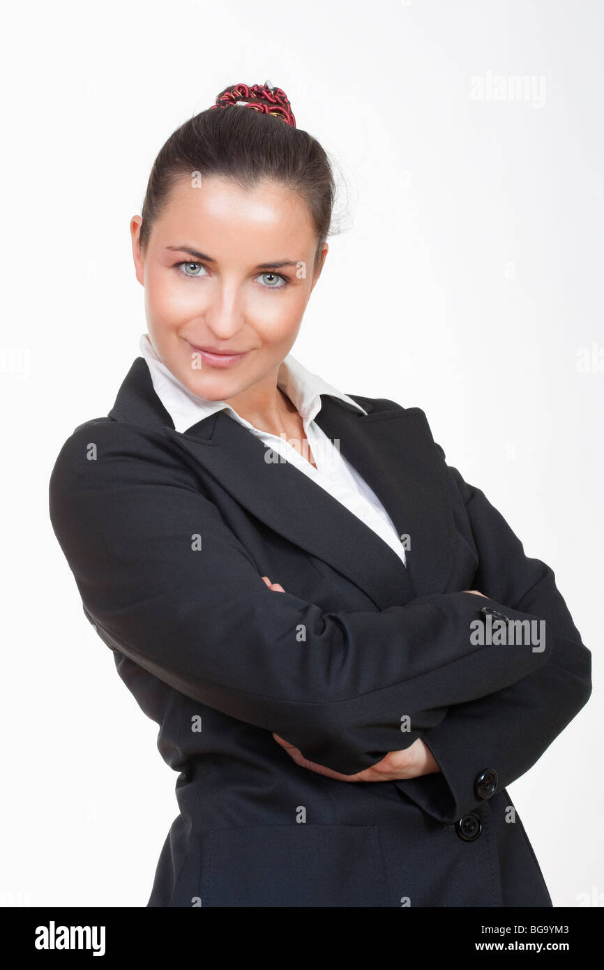 young beautiful businesswoman with her arms crossed looking at camera - Stock Image