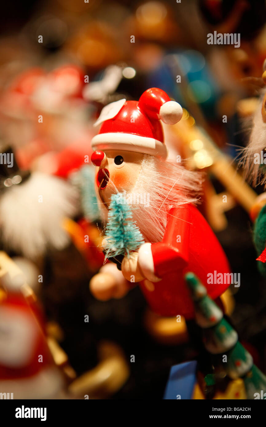 The German Market in Bimingham City Centre at Christmas. Father Christmas hand made toy. - Stock Image