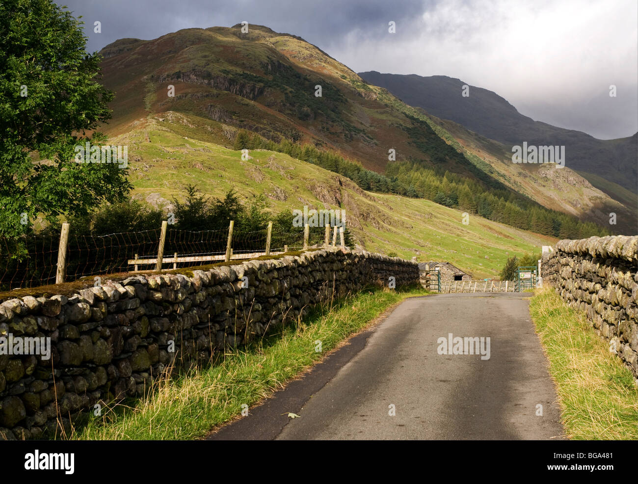 Walk towards ridge known as 'The Band' towards Bowfell, Lake District, Cumbria, UK - Stock Image