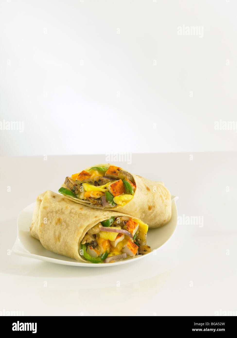 Grilled chicken and egg breakfast burrito - Stock Image