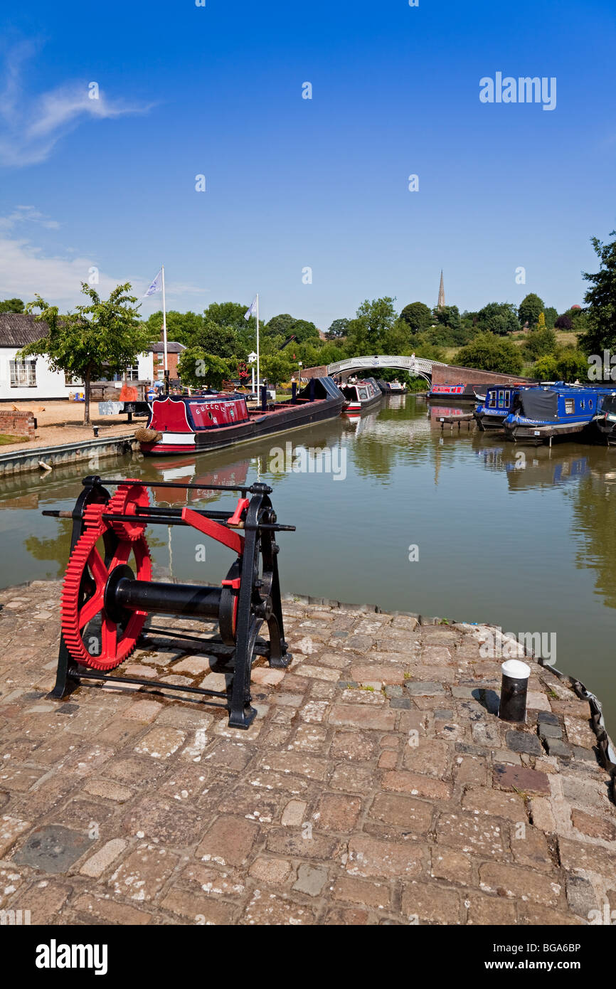 England Northamptonshire Braunston Marina with footbridge and boat 'Sculptor' - Stock Image