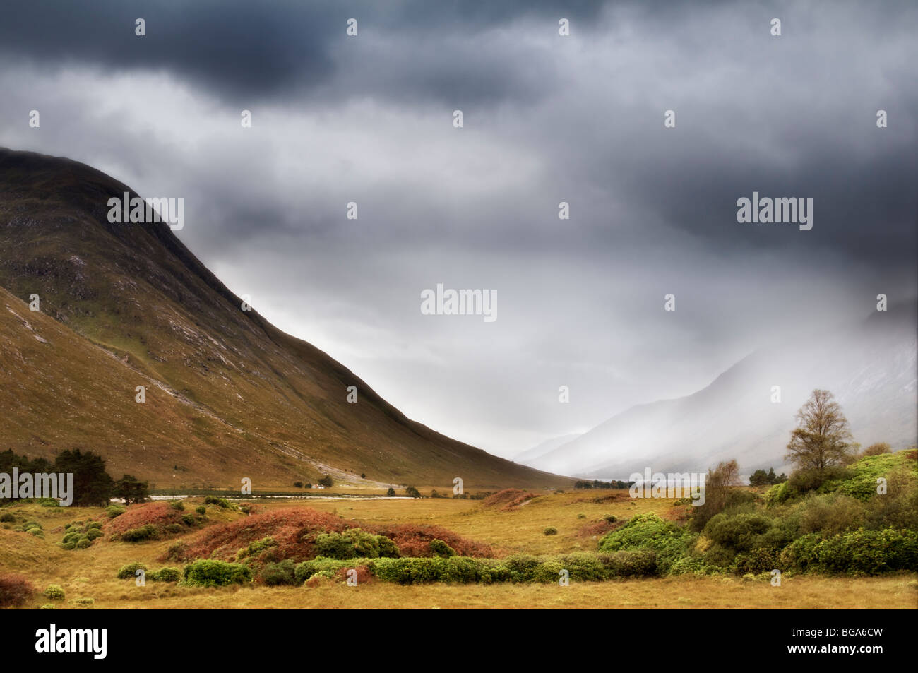 Glen Etive, Glencoe region in Scotland with mist and rain coming in, taken in early autumn - Stock Image