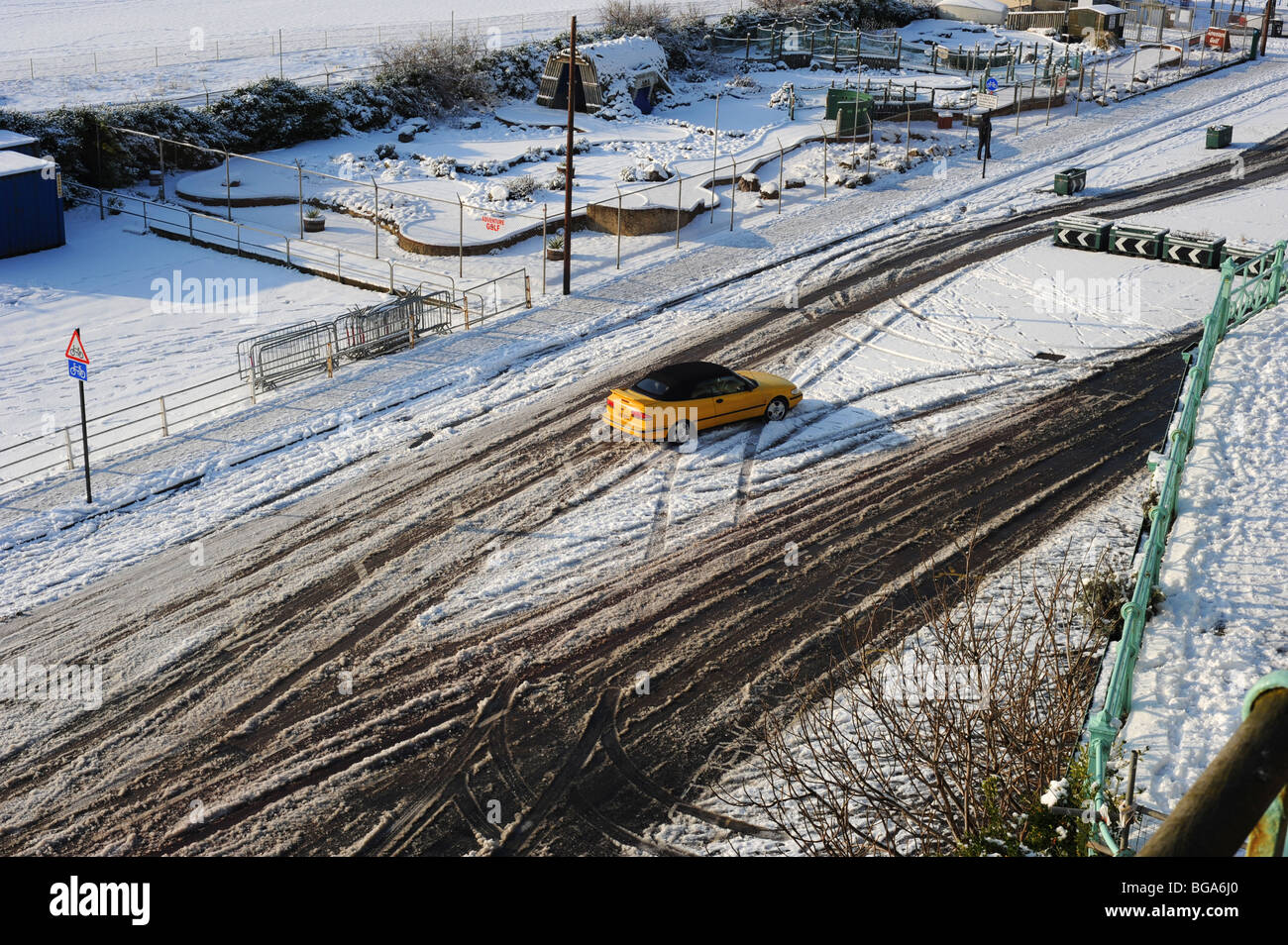 A car skids on maderia drive in brighton after a heavy fall of snow - Stock Image