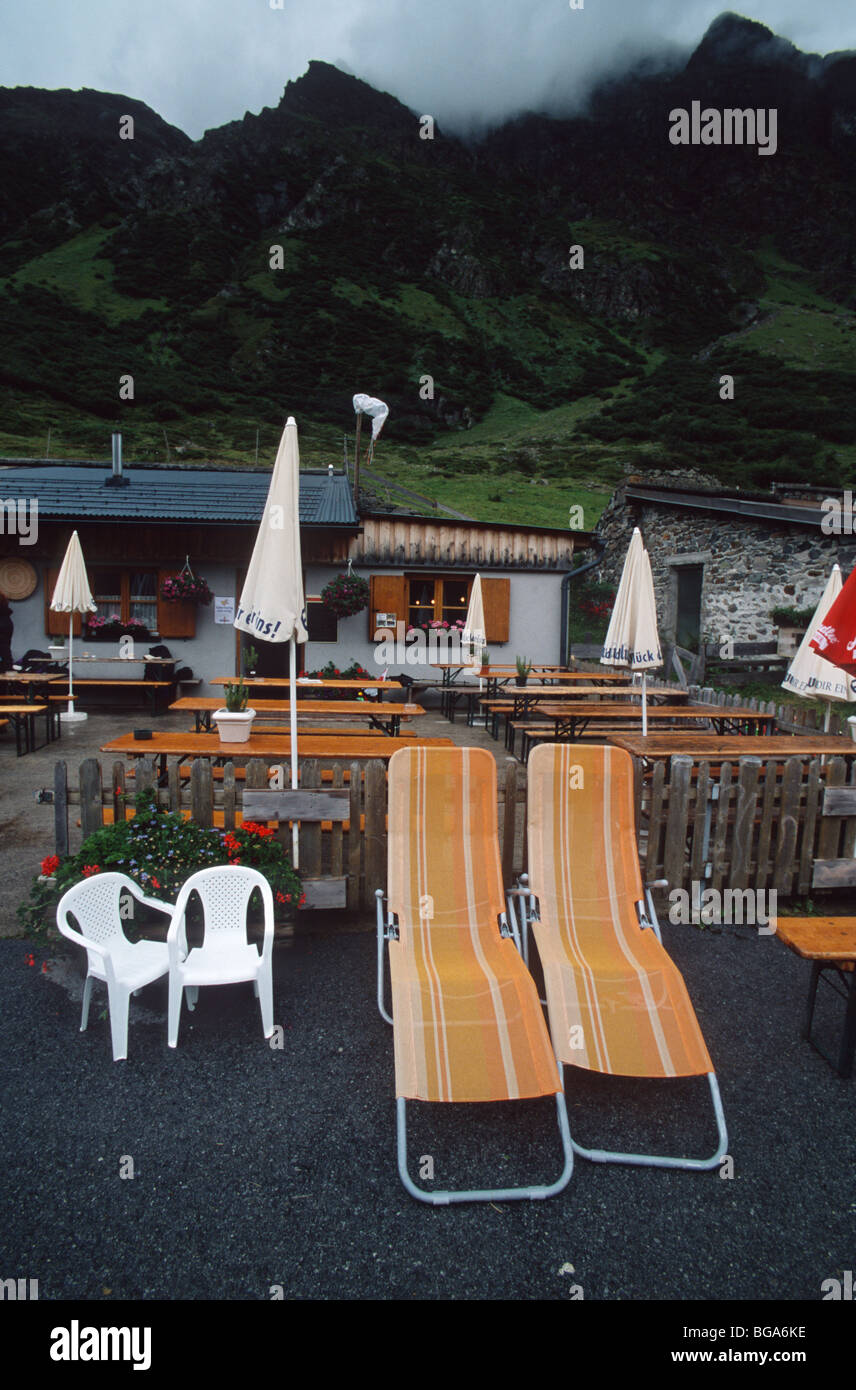 Empty benches and seats at a refuge in the Silvretta mountain range, Alps, Austria - Stock Image