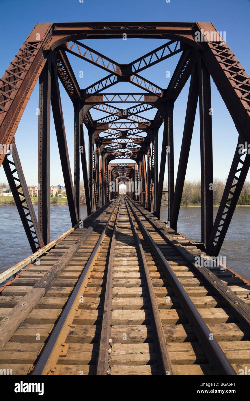 Railroad tracks through a steel railroad bridge, Laval, Quebec, Canada - Stock Image