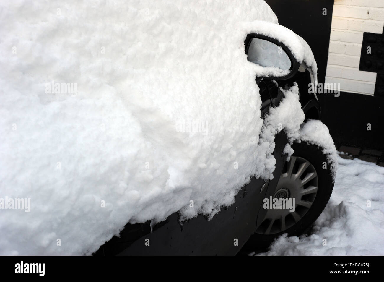 Heavy snowfall covers parked cars in brighton - Stock Image