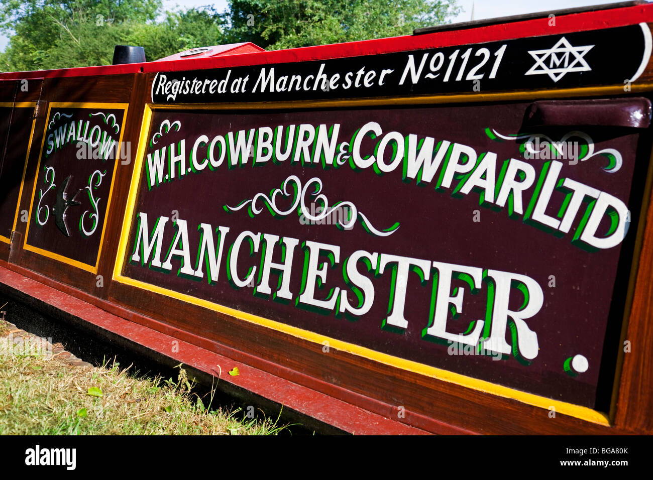 England Northamptonshire Braunston Detail of freight barge 'Swallow' (W. H. Cowburn and Cowpar Ltd.) - Stock Image