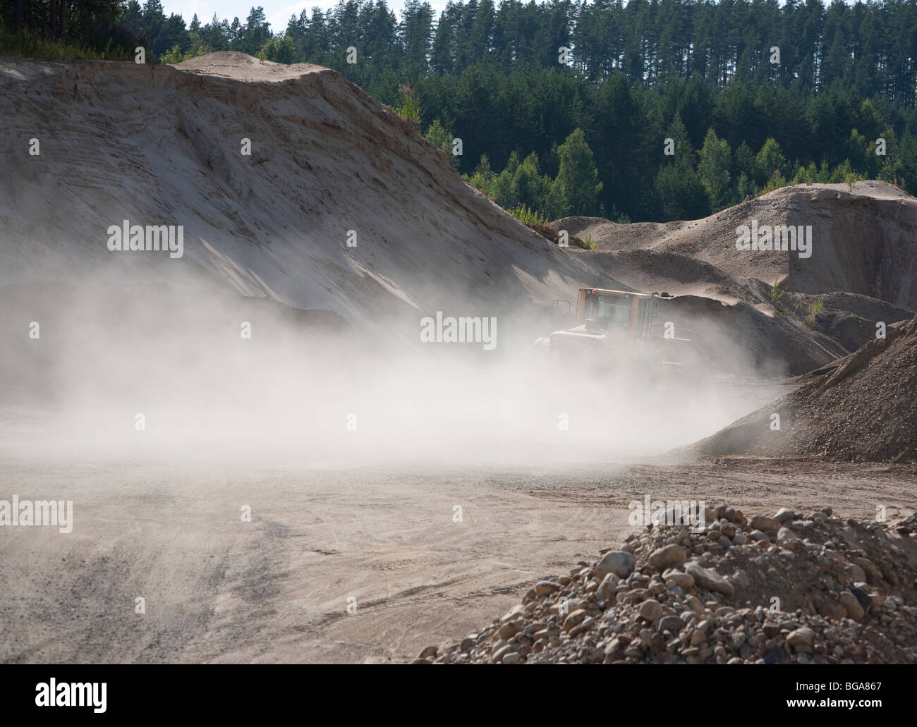 Front loader moving sand in a sandpit - Stock Image