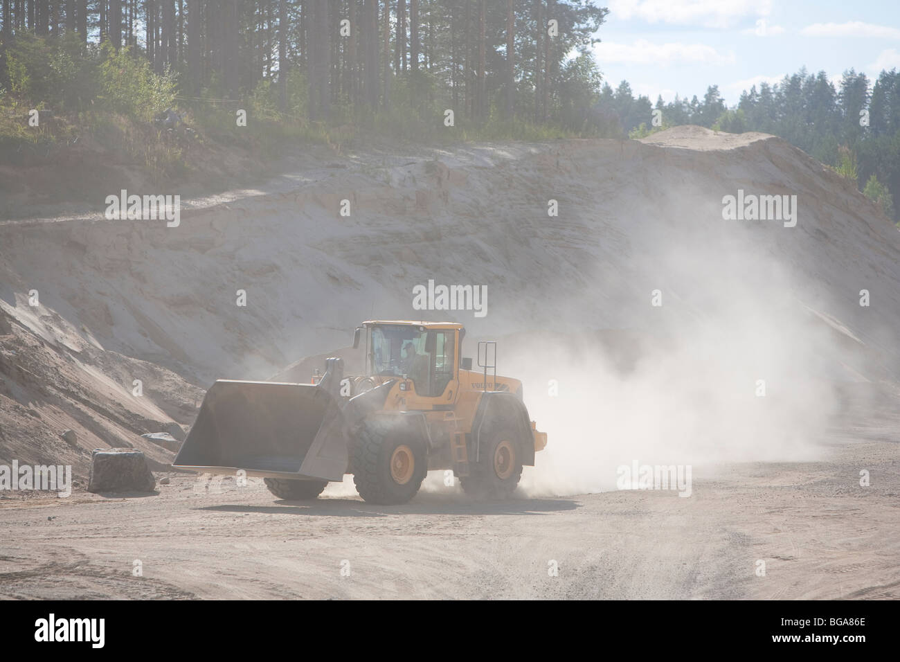 Front loader moving sand in a sandpit , Finland - Stock Image