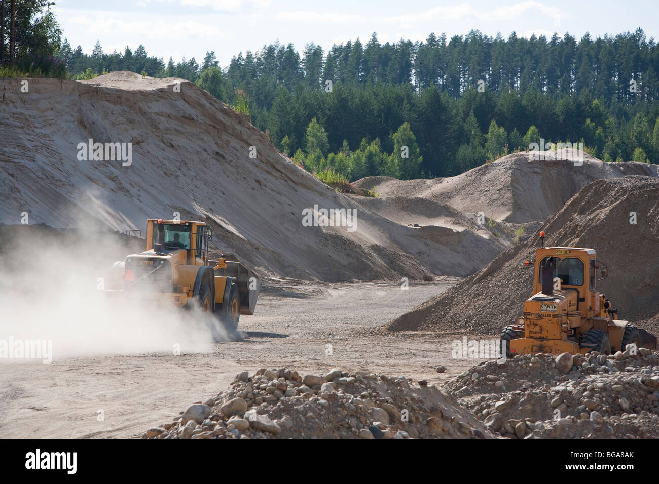 Front loader moving sand in a gravel pit , Finland - Stock Image