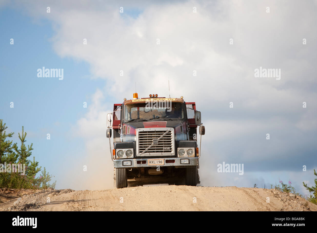 Old Volvo lorry transporting sand from a sandpit - Stock Image