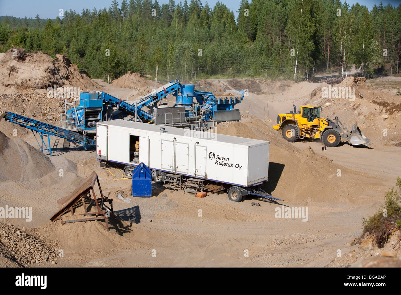 Sand and gravel extraction  and rock crusher equipment at the bottom of a sandpit , Finland - Stock Image
