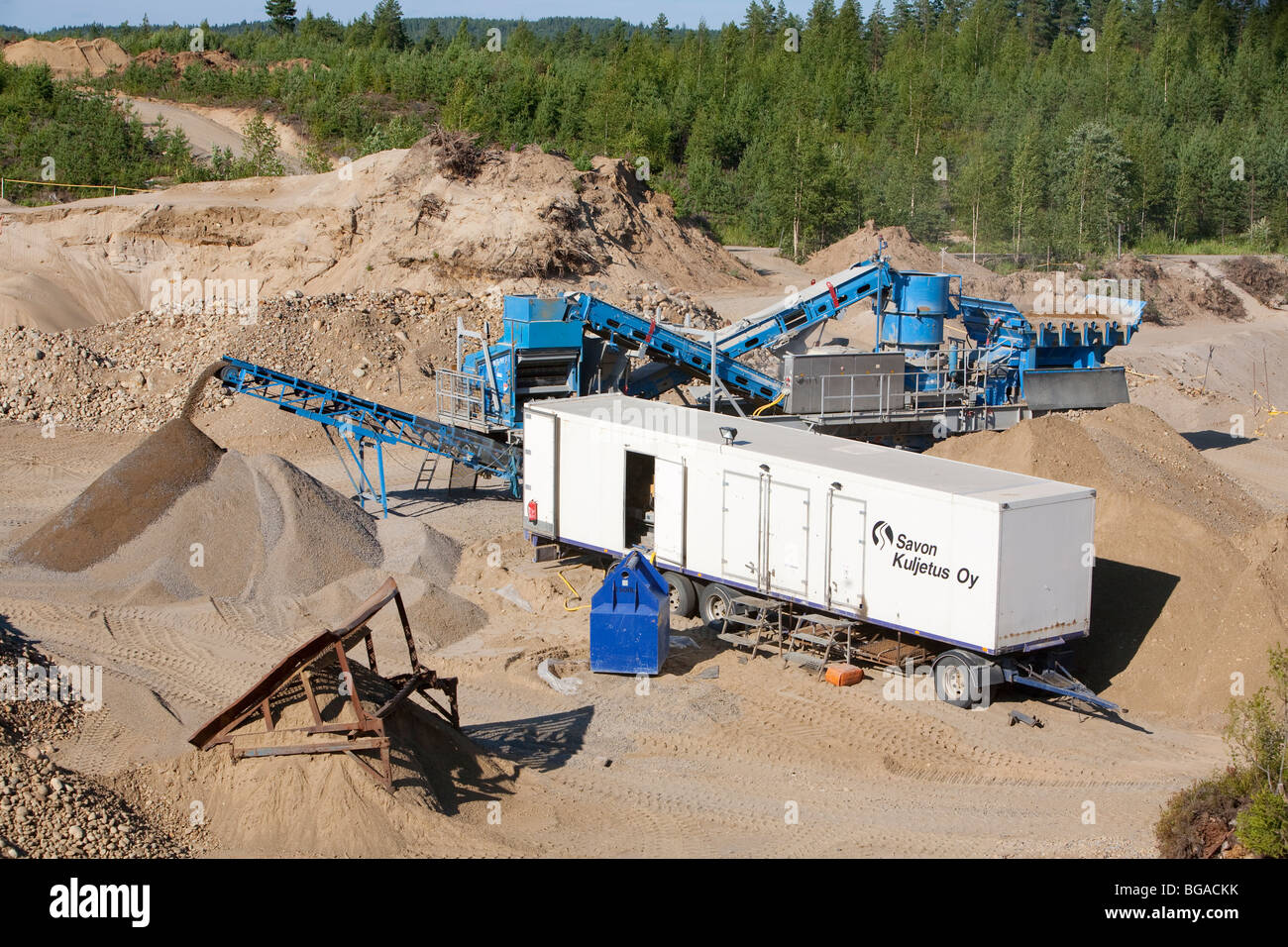 Sand and gravel extraction equipment at the bottom of a sandpit , Finland - Stock Image