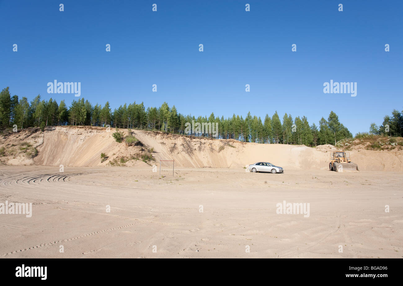 Gravel pit bottom where fine sand is extracted from an ice-age esker ridge , Finland - Stock Image