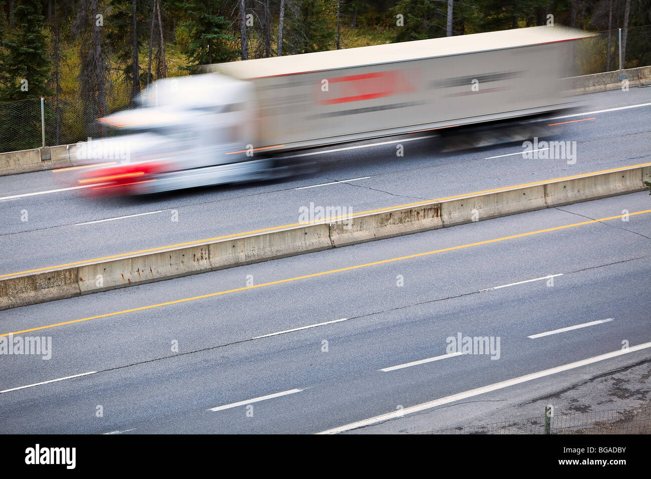 Motion blurred image of a transport truck on the Trans-Canada Highway, Banff National Park, Alberta, Canada. - Stock Image