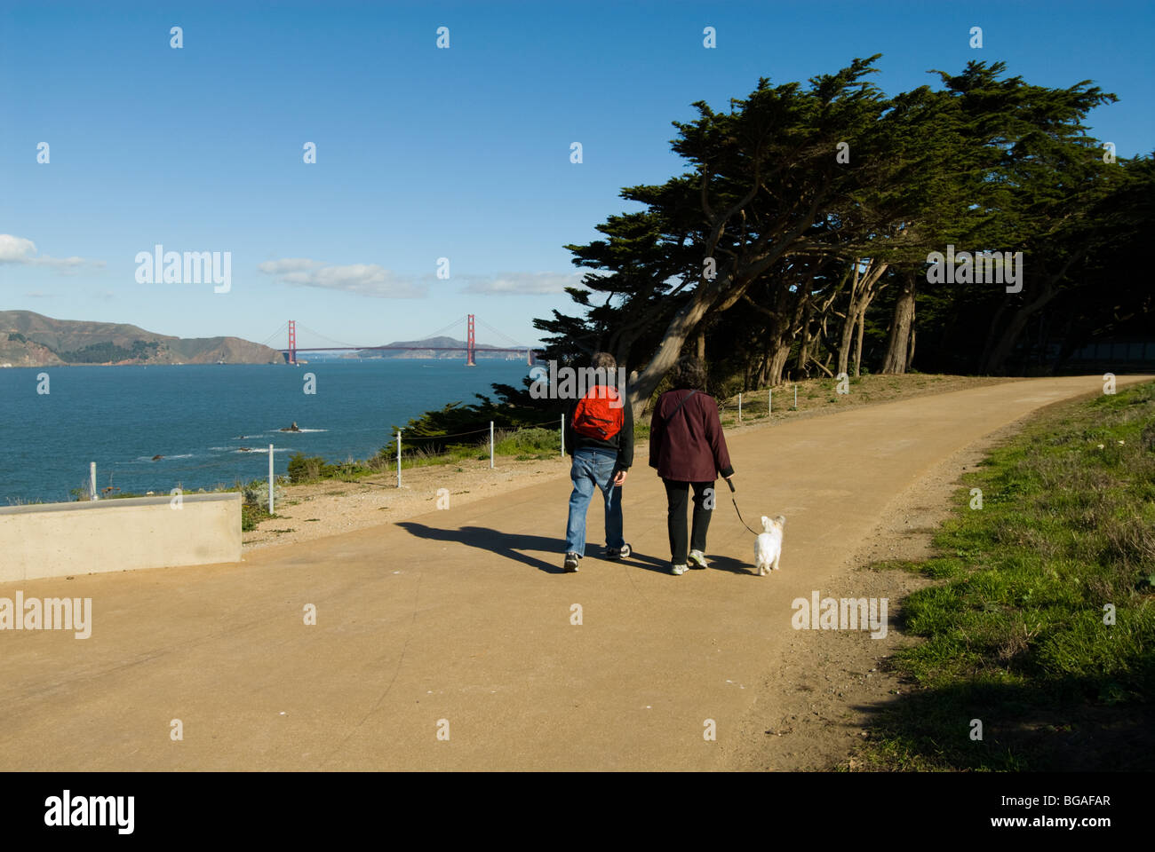 California: San Francisco. Hikers at Land's End, view of Golden Gate Bridge. Photo copyright Lee Foster. Photo - Stock Image